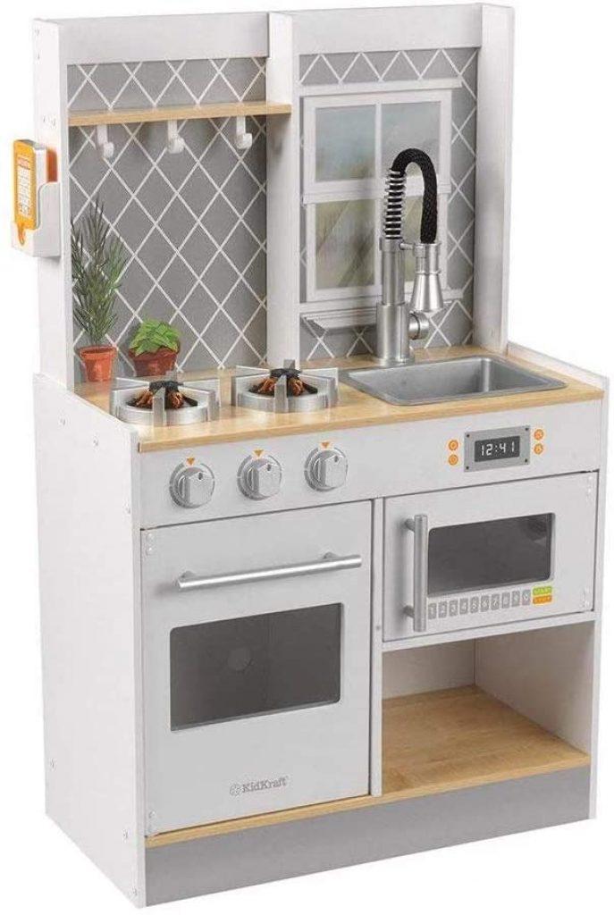 Cette cuisine Kidkraft Lets Cook a un robinet moderne.