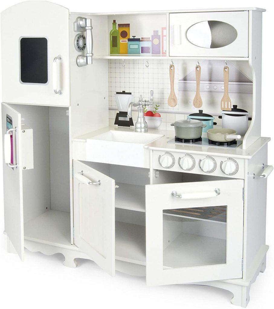 Cette cuisine en bois enfant est de couleur blanche.