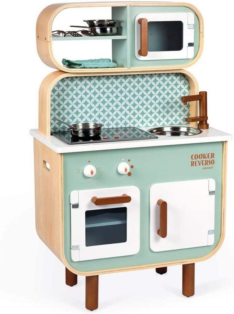 La cuisine Janod en bois jouet Cooker Reverso est de couleur vert d'eau.