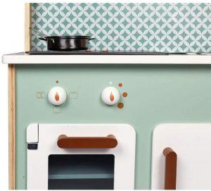 La cuisine Janod Cooker Reverso dispose d'un four avec deux boutons.