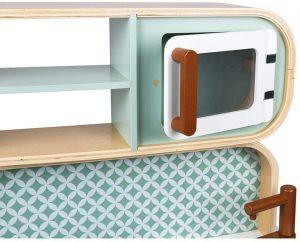 Le micro ondes de la Janod cuisine Cooker Reverso a une porte qui s'ouvre.